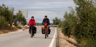Bicycle Touring In Spain. A couple ride their bicycles through the Spanish countryside in the Andalucia region royalty free stock photos