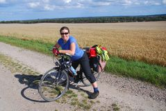 Bicycle Tourist. A woman on a bicycle tour in Denmark Stock Photography