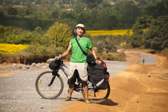 Bicycle tourist on the rural road Stock Photography