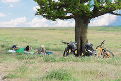 Bicycle Tourists Resting Near Tree Royalty Free Stock Photography