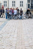 Bicycle tourists on square in Amalienborg Stock Images