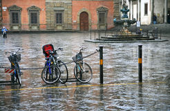 Bicycle on town square in rain Stock Photo