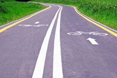 Bicycle track. Asphalt bicycle track in the green field - sport concept Royalty Free Stock Photography
