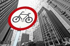 Bicycle traffic permission board between buildings in perspectiv. City concept : bicycle traffic permission board between buildings in perspective Royalty Free Stock Photo