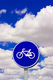 Bicycle traffic sign. Against beautiful sky Royalty Free Stock Photo