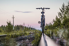 Bicycle by the train railways. stock image