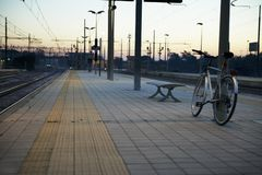 Bicycle at train station of Treviglio town in Italy royalty free stock photos