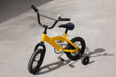 Bicycle with training wheels Stock Images