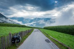 Bicycle traveling in Italy. Alps stock photography