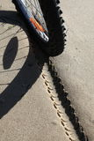 Bicycle tyre shoe tracks on sand. Royalty Free Stock Photos