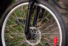Bicycle tyre with sporks isolated object photograph. The sport bicycle front tyre with metallic sporks isolated object unique abstract stock photograph Royalty Free Stock Photography