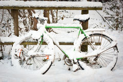 Bicycle under pack of snow. Green bicycle under pack of snow Stock Photos