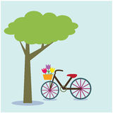 Bicycle under a tree on background. Royalty Free Stock Photography