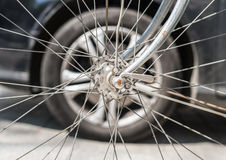 Bicycle versus car. Wheels against each other. Stock Photos
