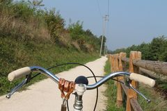 Bicycle, view with dirt road Stock Images
