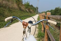 Bicycle, view with dirt road Stock Image
