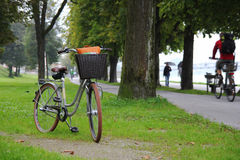 A bicycle on a view of a park, a river and mountains. Royalty Free Stock Photo