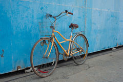 Bicycle. Vintage bicycle with old blue background Stock Photo
