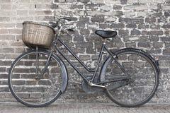 Bicycle at wall Royalty Free Stock Image