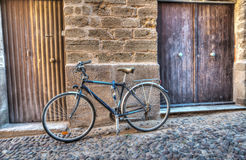 Bicycle by the wall in Alghero old town Stock Photography