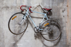 Bicycle on the Wall. Bicycle on the Concrete Wall Stock Image