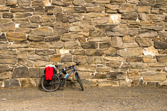 Bicycle at a wall Stock Photos