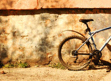Bicycle at the wall on a sunny day. Picture of a bicycle on a sunny day Royalty Free Stock Images