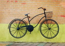 The bicycle on the wall royalty free stock photo