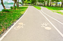 Bicycle way in garden. Bicycle way in green garden of the town Royalty Free Stock Photography