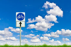 Bicycle way sign on fresh spring green grass Royalty Free Stock Photos