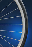 Bicycle Wheel. Closeup of a Bicycle Wheel with blue spotlight background stock photos