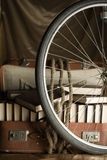 Bicycle Wheel And Old Torn Suit-case Full Of Books