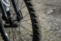 Bicycle wheel close up on the background of road Royalty Free Stock Image