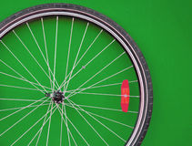 Bicycle wheel. Close up on green background stock image