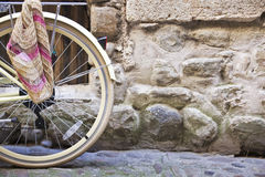 Bicycle wheel on a cobblestone street Stock Image