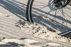Bicycle wheel is deeply in the sand Stock Images