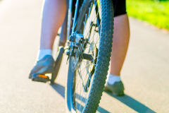 Bicycle wheel and foot girl Stock Photo