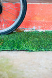 Bicycle wheel on the grass Royalty Free Stock Image