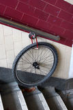 Bicycle wheel locked to a wall handrail. Forgotten bike stolen Stock Image