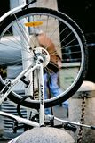 Urban life. Bicycle wheel in an upright position. This is a bicycle wheel, park in the street. It is is in an upright position Stock Image