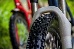 Bicycle wheel after rain. Selective focus Stock Images
