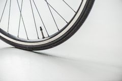 Bicycle wheel with rim, tire and spokes with valve. On white Stock Photos