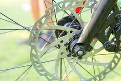 Bicycle wheel on road Stock Photography