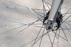 Bicycle Wheel And Spokes. Front wheel and forks of  a bicycle with wire spokes Royalty Free Stock Photography