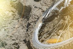 The Bicycle wheel is stuck in the mud. Close up stock photo