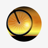 Bicycle wheel at sunset, silhouette of bike forward to sun Stock Photos