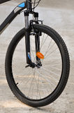 Bicycle wheel with tire. Macro detail of mountain-bike wheel with brakes and reflectors royalty free stock images