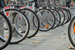 Bicycle wheels. In Lyon, southern France, people can rent bikes from one part of the city and then dropp them off elsewhere at the end of their ride. The system' Stock Photos