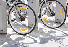 Bicycle wheels. Wheels of rental bicycles on the street Royalty Free Stock Images