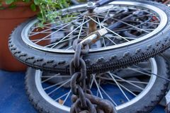 The bicycle wheels is locked with the iron rusty chain - Lost freedom and hope concept.  royalty free stock images